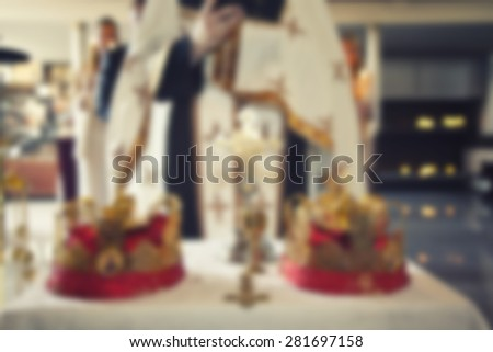 priest in the church ,blurred background - stock photo