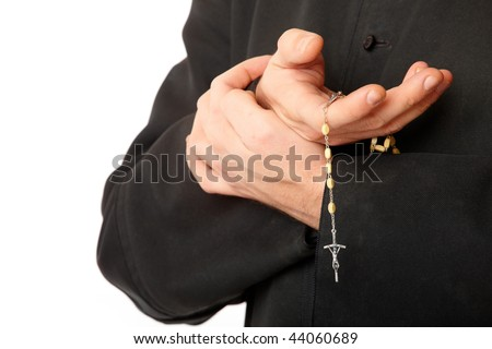 Priest's hands with rosary. Real cassock. - stock photo
