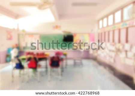 Primary classroom in school with desks chair white board and visual monitor - stock photo