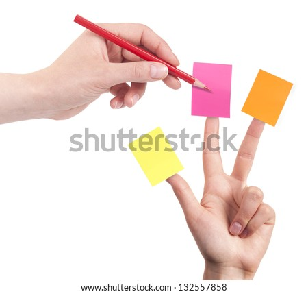 primary goals planning strategy concept - woman's finger with note and pen