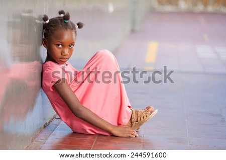 Primary school afro american girl frustrated in schoolyard. - stock photo