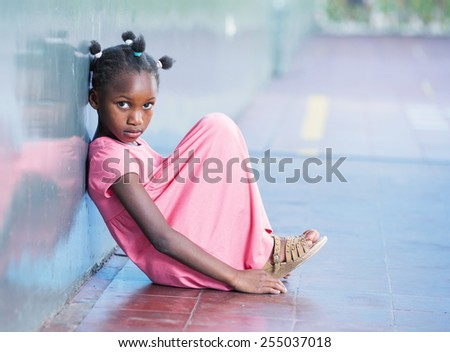 Primary school afro american girl frustrated in schoolyard. - stock photo