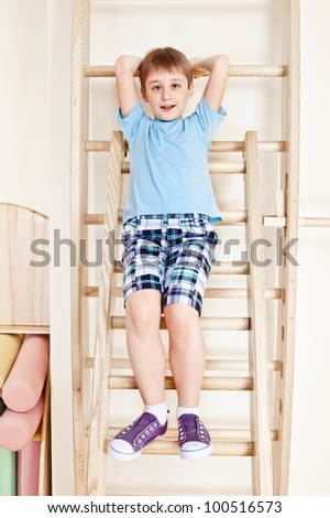 Primary school student sit on wall bars