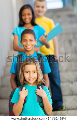 primary school students standing in a row - stock photo