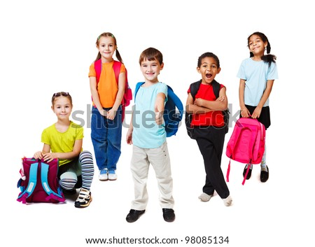 Primary school students with backpacks - stock photo