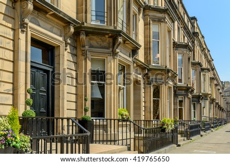 Prime residential property in Drumsheugh Gardens in the west end of Edinburgh.  The buildings are constructed with Blonde sandstone. - stock photo