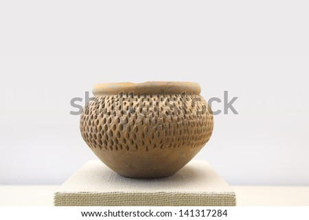 primitive earthen jar with the decoration pattern by banpo people's fingernails,China - stock photo