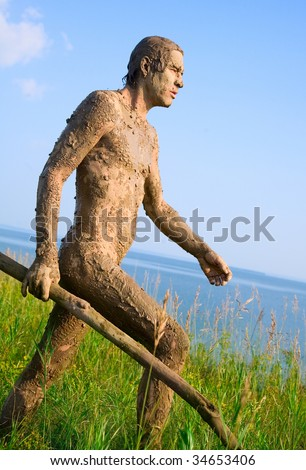 Primitive hunters on the shore of the blue sea - stock photo