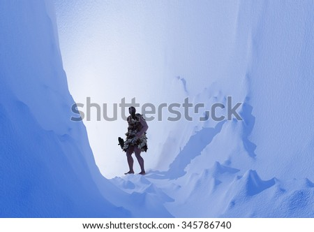 Primitive man in the ice cave. - stock photo