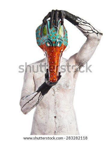 primitive man with fox mask - stock photo