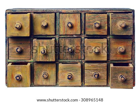 primitive wooden apothecary or catalog cabinet with partially open drawers - storage and sorting concept or just retro background - stock photo