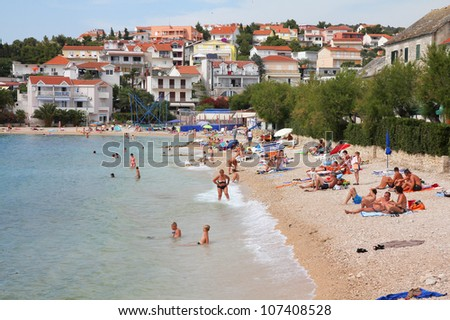 PRIMOSTEN, CROATIA - JUNE 24: Vacationers enjoy the beach on June 24, 2011 in Primosten, Croatia. In 2011 11.2 million tourists visited Croatia, most of them in summer.