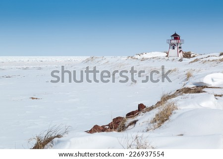Prince Edward Island lighthouse located in the National Park at Covehead, PEI, Canada. - stock photo