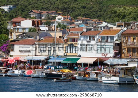 PRINCES ISLANDS, TURKEY - JULY 18, 2015 : View from the ferry, which runs along the route Istanbul - Buyukada . Architecture and tourists on the island Burgaz Adasi