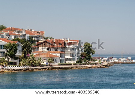 PRINCES ISLANDS, TURKEY - JULY 11, 2014 : View from the ferry, which runs along the route Istanbul - Buyukada. Architecture and tourists on the island Kinaliada