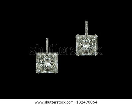 Princess diamonds earrings - stock photo