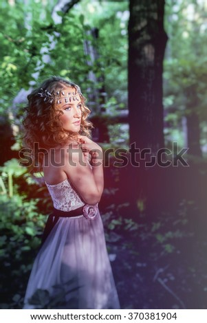 Princess in a magical forest. - stock photo