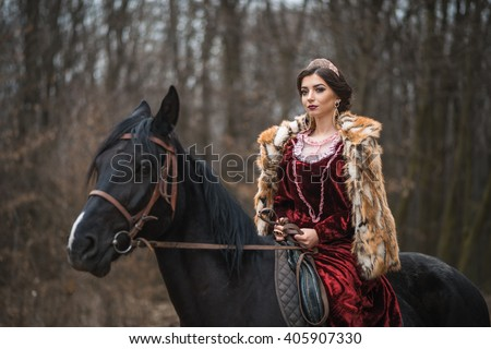 Princess with her horse in the woods