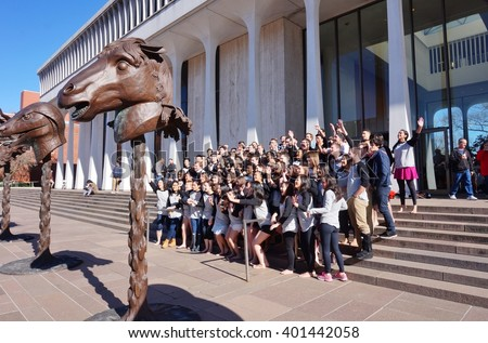 PRINCETON, NJ -5 APRIL 2016- Each year students at the controversially named Woodrow Wilson School at Princeton University jump into the fountain to celebrate the end of their senior thesis.  - stock photo