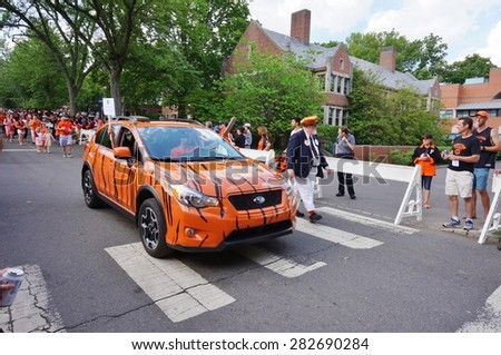 PRINCETON, NJ -MAY 30, 2015- Princeton University alumni dressed in orange and black march joyously in the P-rade, the capstone of the New Jersey college's annual reunions.