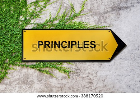 Principles on yellow sign hanging on ivy wall