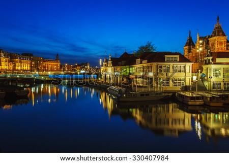 Prins Hendrikkade Street near Centraalstation at Night, Amsterdam - stock photo