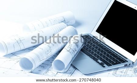 Print. Blueprints and laptop - stock photo