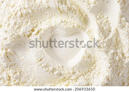 print of heart in the soft wheat flour - stock photo