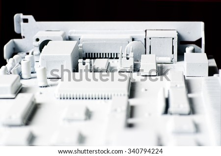 Printed Circuit Board; abstract background image of printed circuit board, white, differential focus  - stock photo