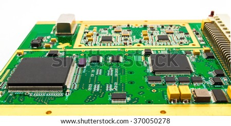 Printed circuit board (PCB) with chip electronic components - stock photo