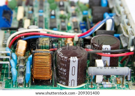 printed circuit board with electronic components - stock photo