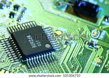 Printed Circuit Board with many electrical components - stock photo