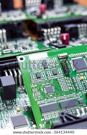 Printed Circuit Boards Placed Bulk with One Another in Laboratory. Vertical Image Orientation
