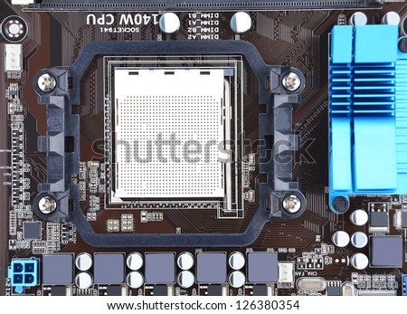 Printed computer motherboard board with microcircuit, close-up - stock photo