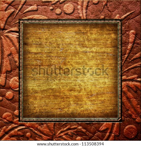 printed leather frame with wooden background