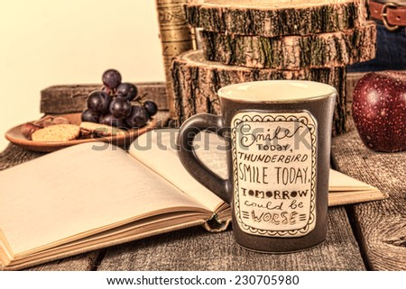 Printed mug on wooden table with open book for relaxing, Relaxation composition with cup of tea or coffee and reading book - stock photo