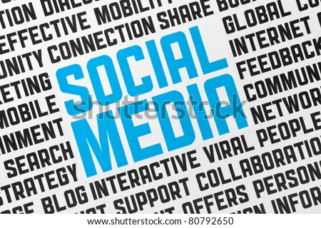 Printed poster on a social media theme. Conceptual image made by word cloud technique. Closeup shot. - stock photo