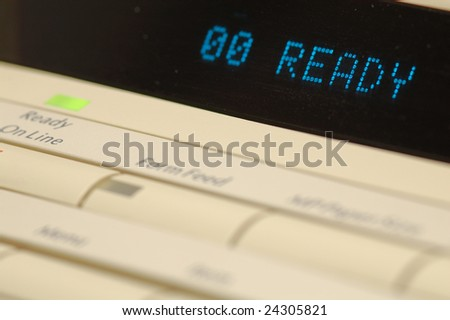 Printer display with a ready sign. Focus on the matrix display and the on-line button.