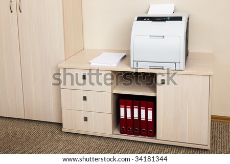 printer from the cabinet in a modern office