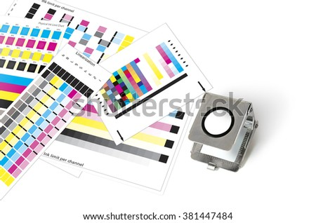 Printers loupe on printed sheet color management patches - stock photo