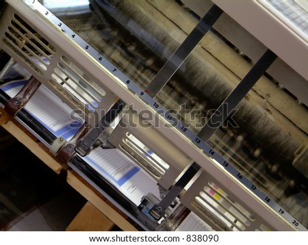 Printing machine in action in printers shop
