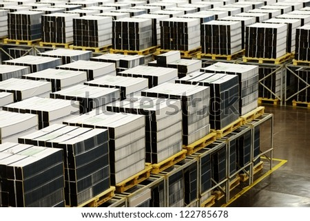 Printing office industry with many books - stock photo