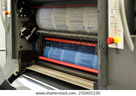 Printing Plenty of Documents or Papers Using Rotary Printing Press Machine. - stock photo
