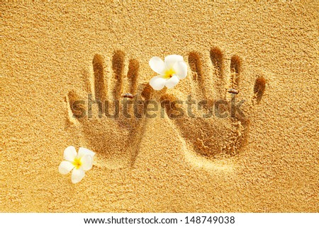 prints of love on the sand - stock photo