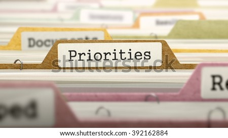 Priorities Concept. Colored Document Folders Sorted for Catalog. Closeup View. Selective Focus. 3D Render. - stock photo