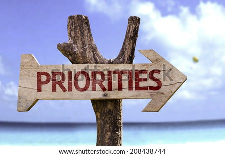 Priorities wooden sign with a beach on background  - stock photo