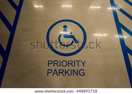 Priority parking.The international markings for a handicapped parking stall in a parking lot