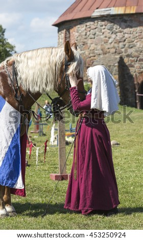 "PRIOZERSK, RUSSIA - JULY 02, 2016: Knight tournament ""Russian fortress"" at the Korela fortress"