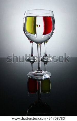 Prismatic view of red and white wine - stock photo