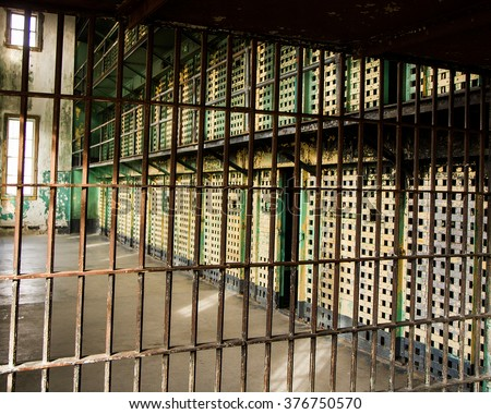 Prison bars used to lock the prisoners away from the world - stock photo